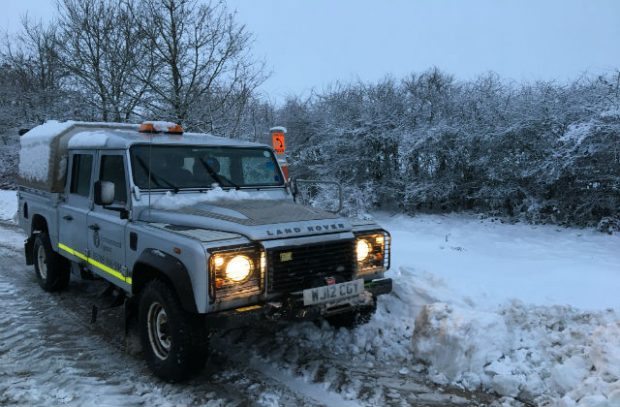 This is a photo of an Environment Agency vehicle on a snowy road