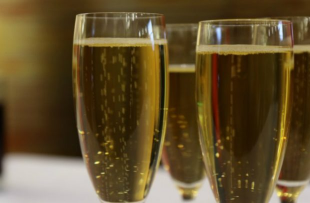 An image of two Champagne flutes of sparking wine