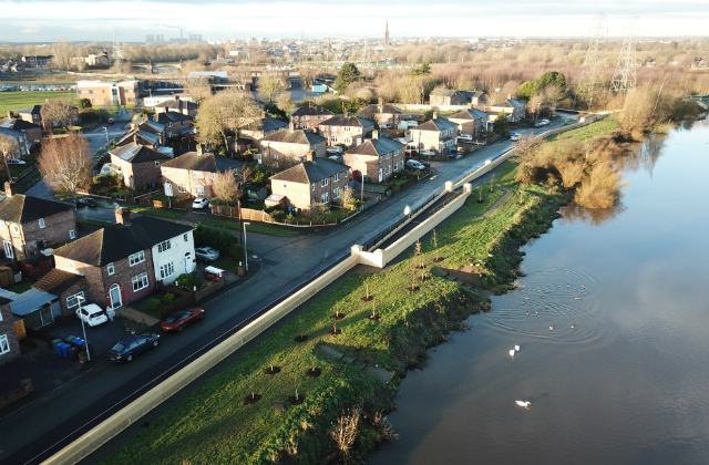images shows a long wall which is part of Warrington's new £34 million flood defence scheme