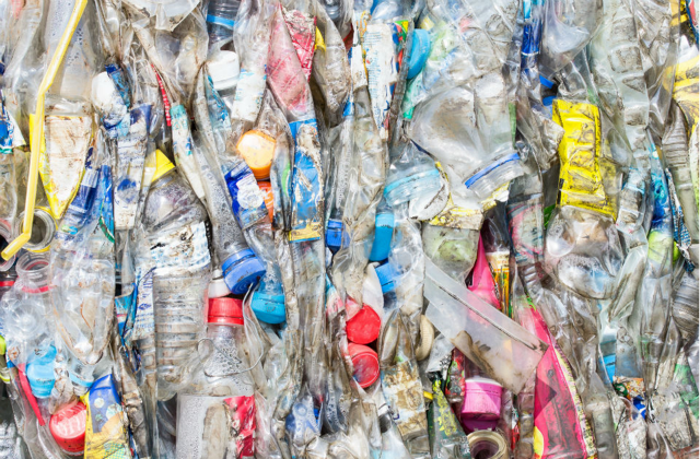 An image of a pile of plastic waste in the process of being treated.