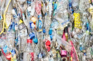Photo of close up shot of bales of plastic bottles ready for recycling