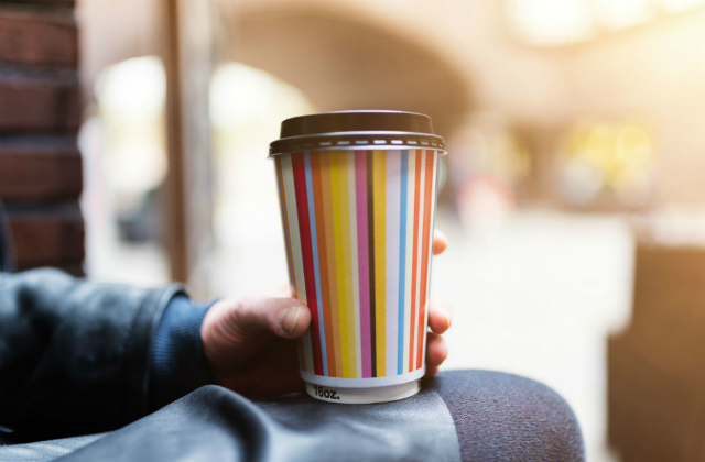 Image of someone holding a reusable cup