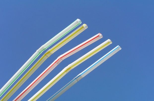 Five drinking straws against the blue sky