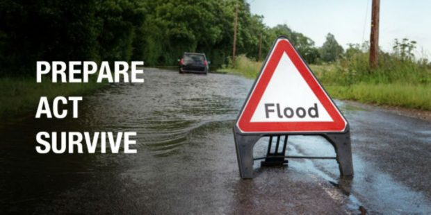 Image of a flood warning sign with says 'flood' with the caption prepare, act, survive.