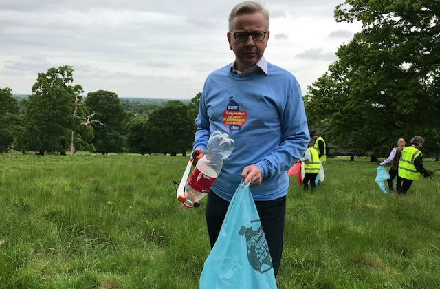 Michael Gove picking litter