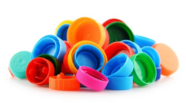 A picture of plastic bottle caps in different colours