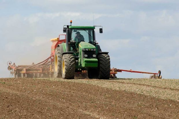 Picture of a tractor in a crop field