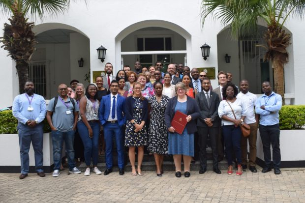 An image of Minister Coffey meeting with the team at the British High Commission in Maputo.