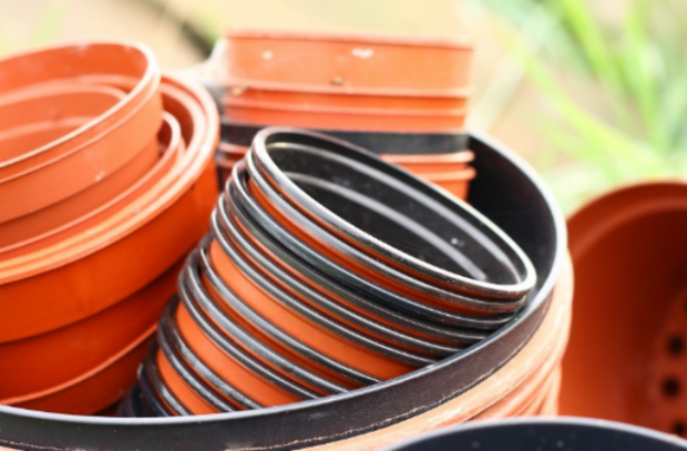 An image of plastic plant pots of various sizes.