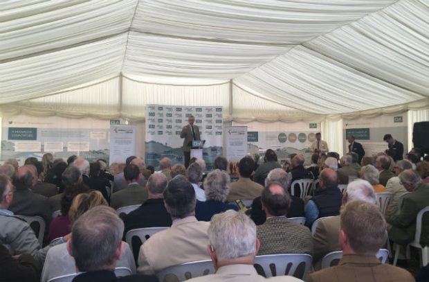 An image of Michael Gove, Enviroment Secretary, speaking to farmers at the Country Land & Business Association tent.