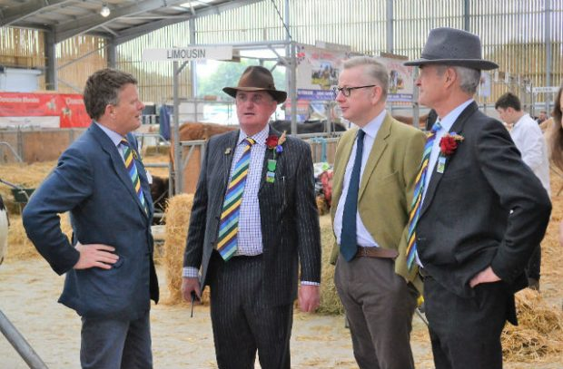 An image of Michael Gove, Enviroment Secretary, meeting with local representatives from the farming unions at the show.