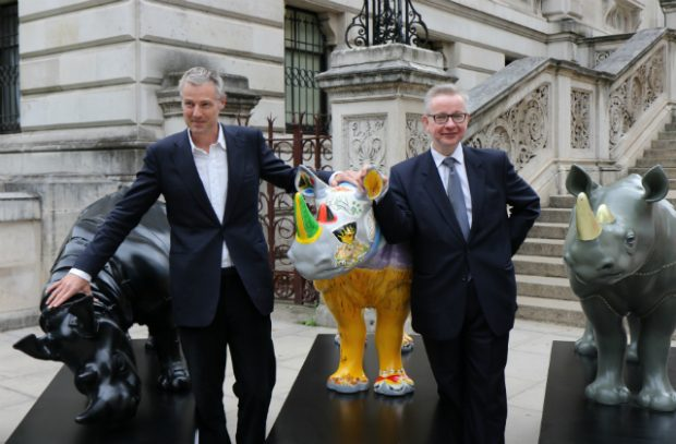Zac Goldsmith MP and the Environment Secretary, Michael Gove standing next to the Tusk Trust statues in Westminster.