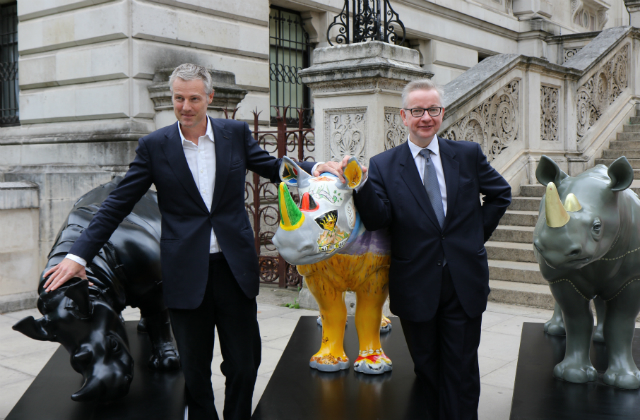 An image of Zac Goldsmith MP and the Environment Secretary, Michael Gove, with the Tusk Trust rhino artworks.