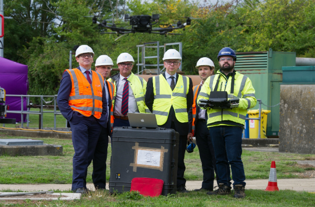 An image of Environment Secretary Michael Gove standing with staff on visit to an Anglian Water site in Gazeley, Suffolk.