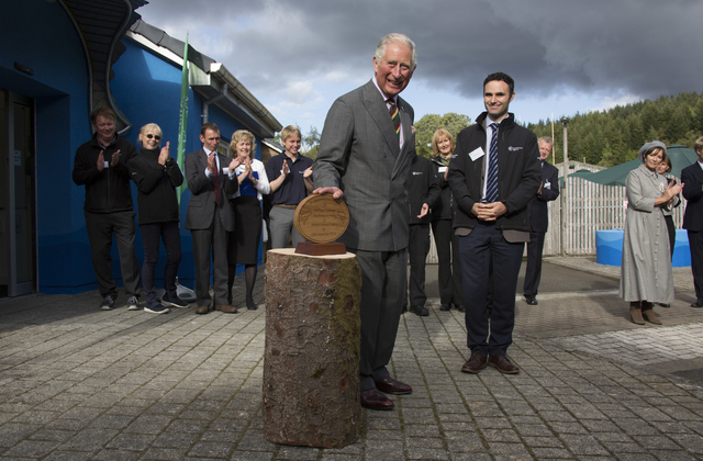 An image of Prince Charles unveiling a commerative plaque for the new visitor centre.