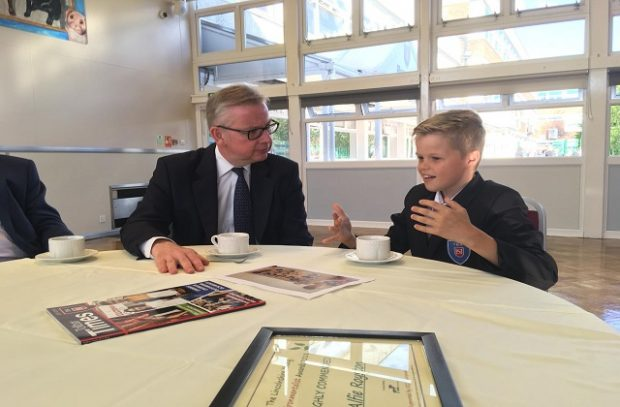 Environment Secretary Michael Gove presenting Alfie Royston from Tollbar Academy with a #refill reusable bottle