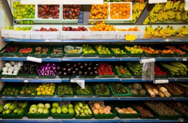 An image of fruits and vegetables at a supermarket.