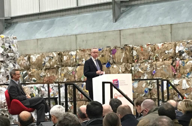 An image of the Environment Secretary speaking on a stage at the Waste to Wealth Summit.