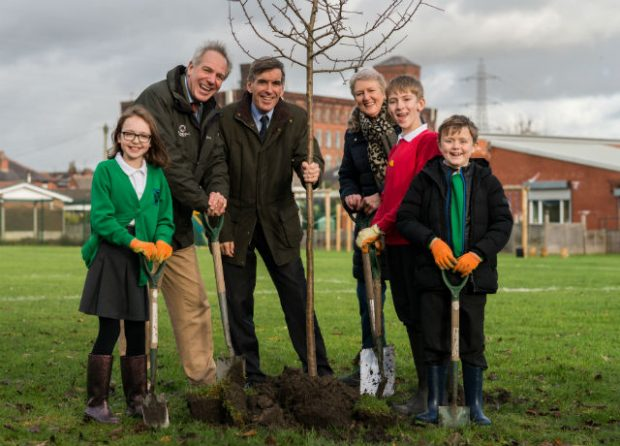 Minister Rutley with Tree Champion Sir William Worsley and pupils from St Andrew's CE Primary School. Photo credit: The Woodland Trust.