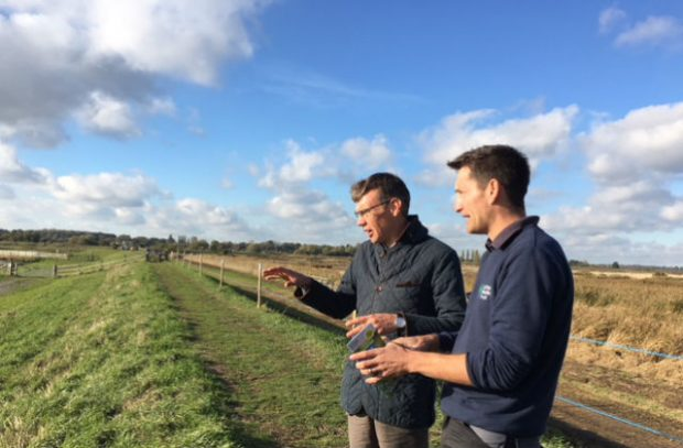 Julian Glover and Matt Gooch from the Suffolk Wildlife Trust in a field in the Broads.