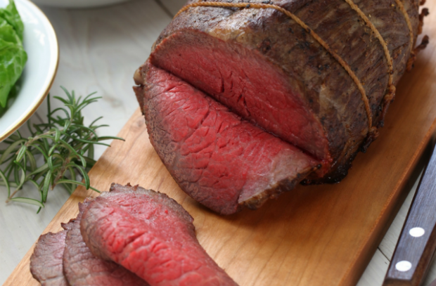 Picture of sliced beef on chopping board.
