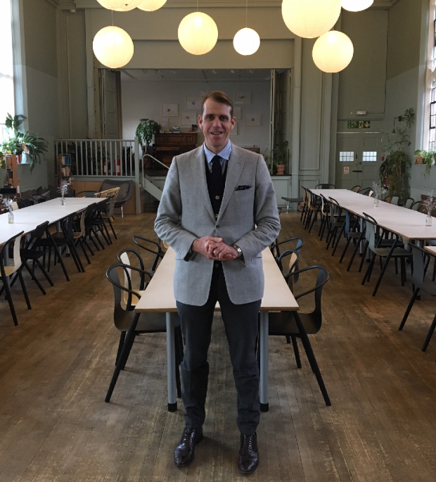 An image of Ben Elliot standing in the restaurant area at Refettorio Felix.