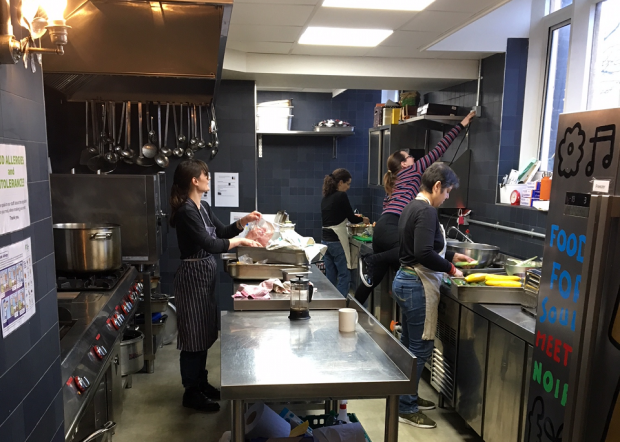 An image of staff in the kitchen at Refettorio Felix.