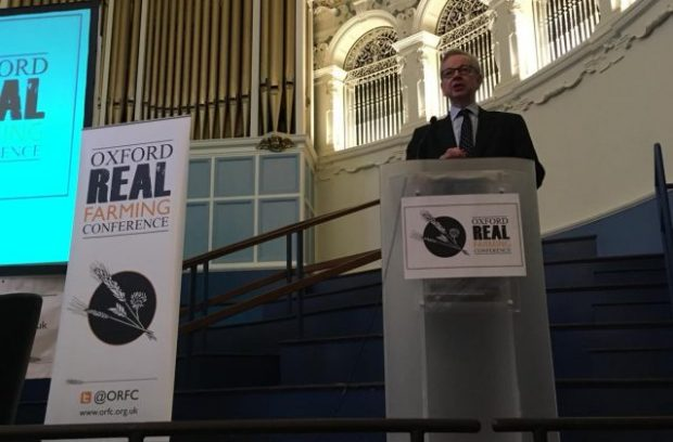An image of the Environment Secretary speaking at a podium at the Oxford Real Farming Conference.