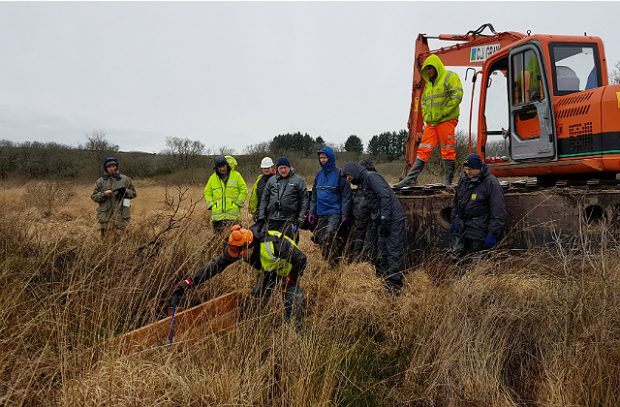 Photograph of people working on Bodmin Park Peatland