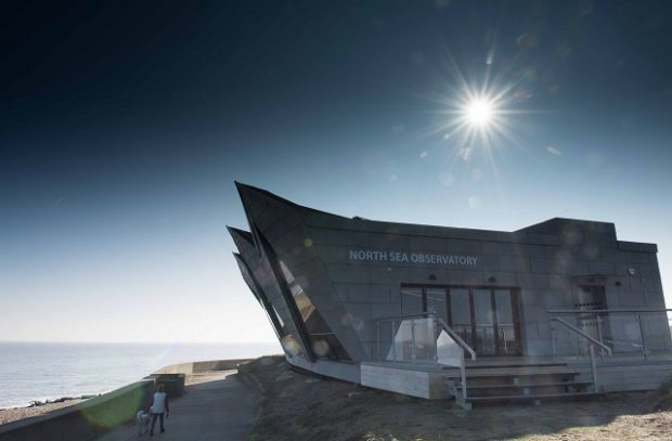 Image of the North Sea Observatory building on a sunny day.