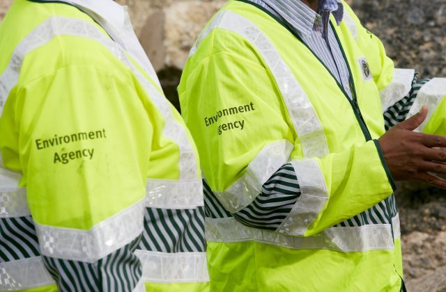 An image of Environment Agency officers in yellow high visability jackets