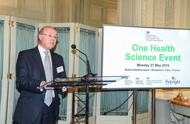 Defra Biosecurity Minister, Lord Gardiner, standing at a lectern, making a speech at the UK One Health reception