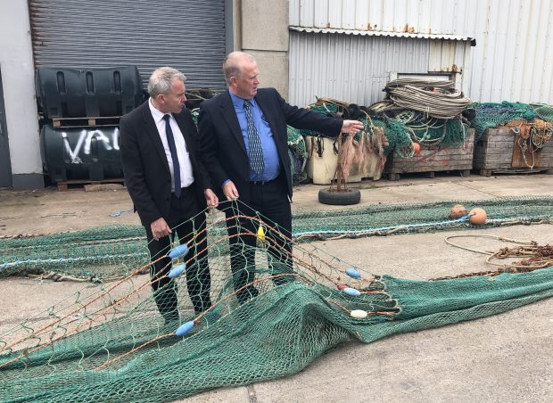 Image showing Agricultural and Fisheries Minister Robert Goodwill inspects a large fishing net