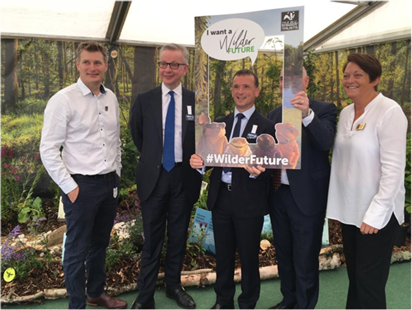 An image of Michael Gove, standing with representatives at the Royal Welsh Show
