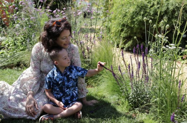 Year of Green Action ambassador Rachel de Thame enjoying the multisensory nature of the garden with a small child.