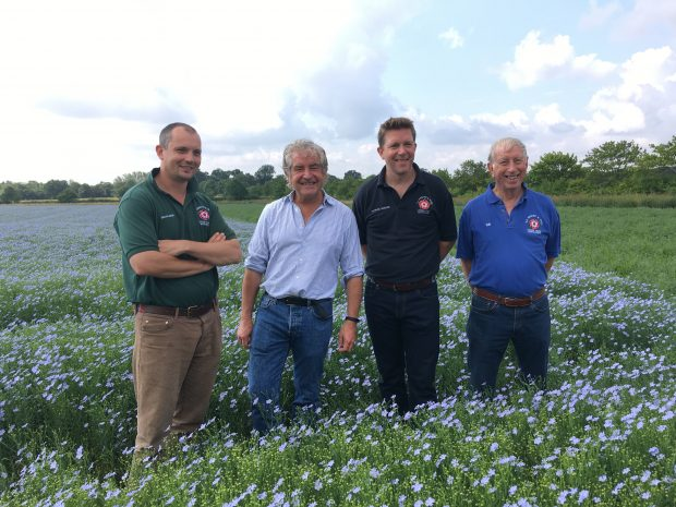 An image of Brian Barker, Tony Juniper, Patrick Barker and David Barker in a field.