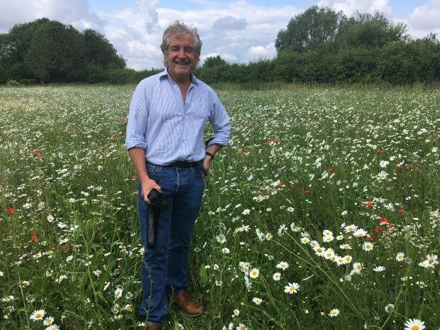 An Image of Tony Juniper in pollen and nectar plot field