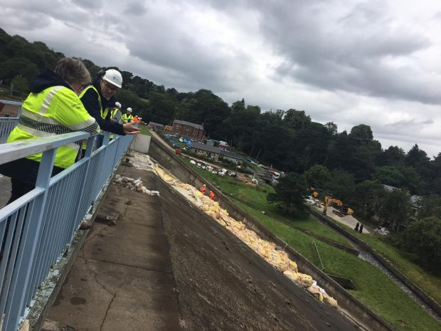 An image of Minister Coffey looking over the recovery efforts at Whaley Bridge.