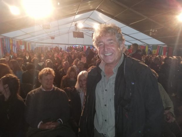 Tony Juniper, chairman of Natural England, standing on stage in front of a crowd in a tent at the Birdfair event at Rutland Water in Leicestershire