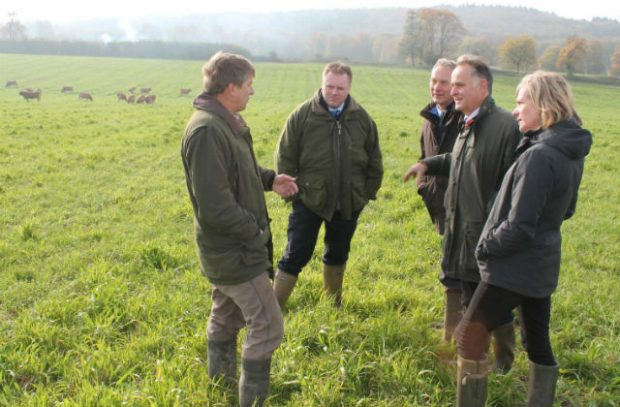 Marian Spain with the NFU and local farmers standing in a field talking
