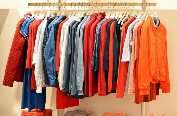 A range of jackets lined up on a clothes rail