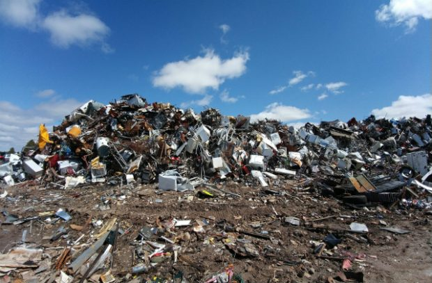An image of piles of rubbish and electrical goods at a landfill site