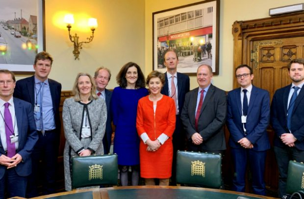 Environment Secretary Theresa Villiers and Minister Rebecca Pow (centre) pose with representatives from a number of stakeholder groups.