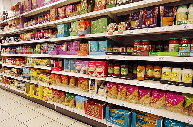 Image of supermarket aisle with full shelve