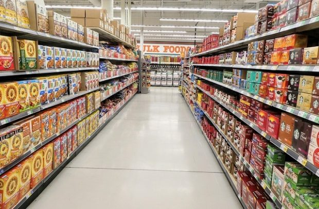 Image of supermarket aisle with full shelves