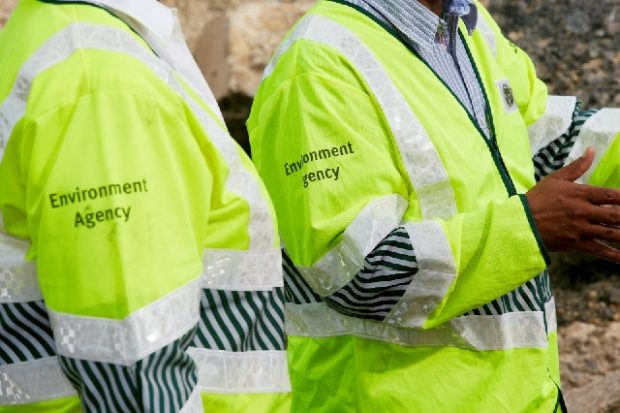 Two people wearing Environment Agency high visibility jackets