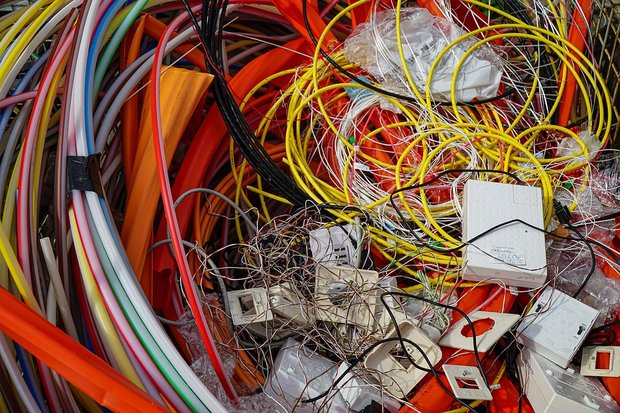 An image of various items of electrical waste including multi-coloured wires and circuit boards.
