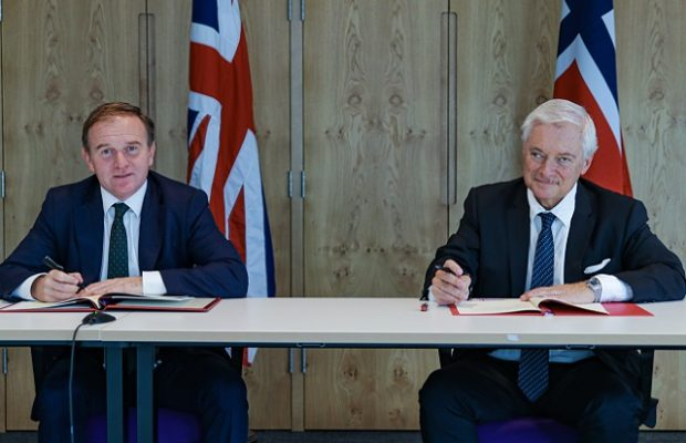 Environment Secretary George Eustice (left) and Norwegian Fisheries and Seafood Minister Odd Emil Ingebrigtsen (right) sign the historic UK-Norway Fisheries Framework Agreement