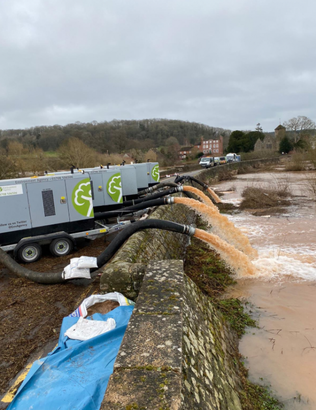 Environment Agency officials pumping flood water away