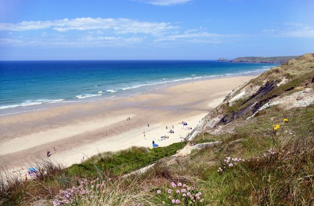 A beach in Cornwall with swimmers